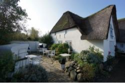 Gehobene Inselgastronomie: 1218 Investment übernimmt Alten Gasthof in Sylt